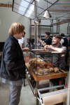 Before coffee and literally over pastries, a barista at Intelligentsia in Venice, Calif. takes time to greet his friend and ask him how he is enjoying the Abbot Kinney Festival outside.